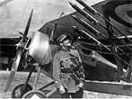 Norman Prince scrutinizes Le Prieur rockets mounted on the outboard wing struts of a Nieuport Baby. No location; circa 1916 (Photo by Smithsonian Institution)
