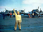 Flight deck crews - US Navy training film (Launching Aircraft) - The Flight Deck Officer gives Thumbs Upto Fly Control. 6 January 1943 (Photo by USN Slide Collection at the national Archives)