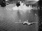 USAF B-25 engaged in mast head bombing in New Guinea. Image is of B-25s that was taken by a US government employee during World War II and will be used in the B-25 article to illustrate the wartime use of the aircraft. This aircraft is (Here's Howe) of the 90th Bomb Squadron during the November 2, 1943 attack on Simpson harbor. It isn't 13th Bomb squadron as indicated. (Photo by USAAC)