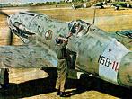 A ground crewman is talking with the pilot of a Italian Macchi MC.202 Folgore (Thunderbolt) Fighter Aircraft in 1943.