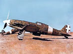 The Italian Macchi MC.202 Folgore (Thunderbolt) Fighter Aircraft on an airfield in North Africa. The Italians were good at making aircraft that were maneuverable and pleasant to fly, but not so good at making high-performance engines. Aeronautica Macci sidestepped this problem by importing some German DB601's, the same engine that powered the Me109, dropping it into the obsolescent MC.200, and the Folgore was born. It was an excellent aircraft, albeit somewhat underarmed, and continued in service until the end of the war.