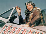 American ace fighter pilot Captain Fred J. Christensen in the cockpit of his P-47 Thunderbolt fighter, c.1944. Each of the 22 swasitkas painted on the fuselage of the plane represents a German aircraft destroyed. (Photo Getty Images)