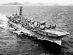 The Royal Navy aircraft carrier HMS Triumph (R16) underway off Subic Bay, Philippines, during exercises, 8 March 1950. Planes on her deck include Supermarine Seafires, forward, and Fairey Fireflys aft. (USN Photograph)