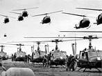 U.S. Army UH-1D Iroquois helicopters providing support for U.S. ground troops fly into a staging area fifty miles northeast of Saigon, Vietnam in January of 1966. (AP Photo/Henri Huet, File)