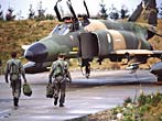 Pilots approach an F-4E Phantom II aircraft parked on the during Exercise Reforger '82.