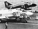 U.S. Navy F-4J Phantom II and Royal Navy Phantom FG.1 (F-4K) fighters on the catapults of the U.S. aircraft carrier USS Independence (CV-62) off Florida in March 1975. (USN)